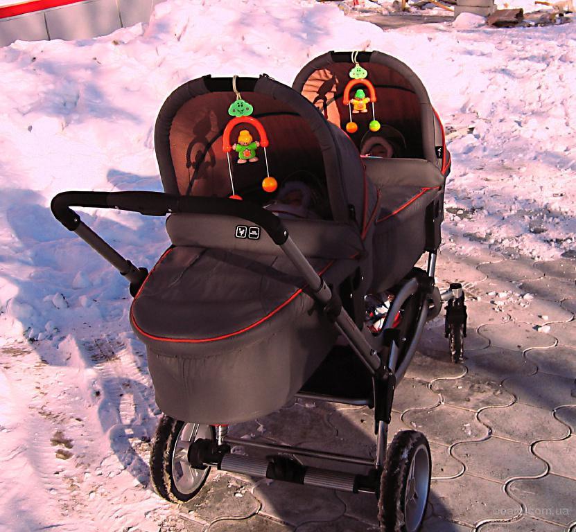 Какую коляску на зиму новорожденному